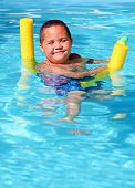 picture of floaties  - Cute latino african american child relaxing in pool - JPG