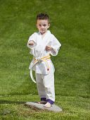 pic of jiujitsu  - Young boy practicing martial arts outside in spring - JPG