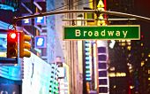 image of broadway  - Broadway sign and red stop light in New York City at night - JPG