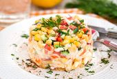 foto of crab  - Fresh vegetable salad with corn pepper crab cucumber eggs and mayonnaise - JPG