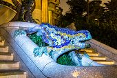 pic of gaudi barcelona  - Sculpture of a salamandra of Antoni Gaudi in the park Guell in Barcelona Spain in a summer night - JPG