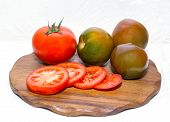 stock photo of cutting board  - red tomatoes and  - JPG