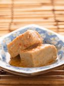 foto of fermentation  - close up of a bowl of chili fermented bean curd tofu - JPG