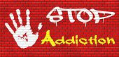 stock photo of drug addict  - stop addiction of alcohol gaming internet computer drugs gamble addict get them to rehab or rehabilitation graffiti on red brick wall, text and hand  - JPG