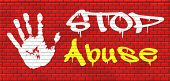 stock photo of pedophilia  - stop abuse child protection prevention from domestic violence and neglection end abusing children graffiti on red brick wall - JPG