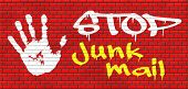 pic of spam  - stop junk mail and spam graffiti on red brick wall - JPG