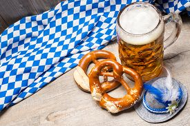 image of pretzels  - Bavarian beer mug and pretzels on a rustic wooden table - JPG
