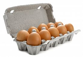stock photo of tens  - Cardboard egg box with ten brown eggs isolated on white background - JPG
