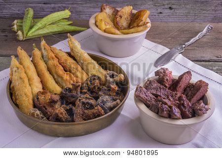 Cajun Style  Grilled Entrecote, With Deep Fried Okra, Mushrooms And Glazed Sweet Potatoes
