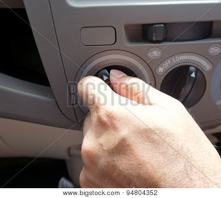Male Driver Turning Car Air Conditioner Knob