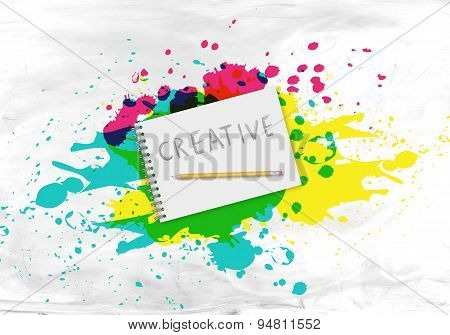 Writing pad with a pencil in the center of splatters