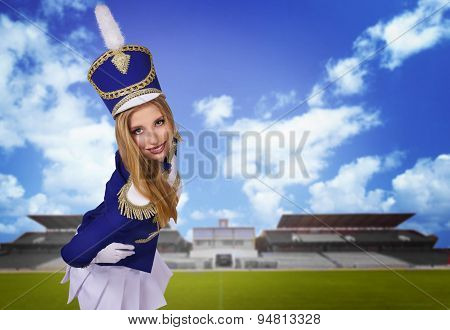 beautiful blonde cheerleader drummer majorette  on the playground with green grass