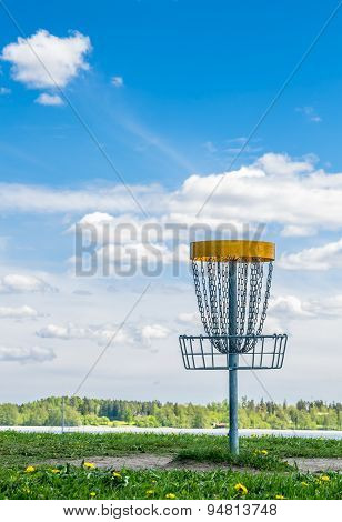 Disc Golf Basket On The Grass