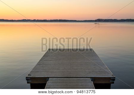 Wooden Pier In The Scandinavian Evening Lake