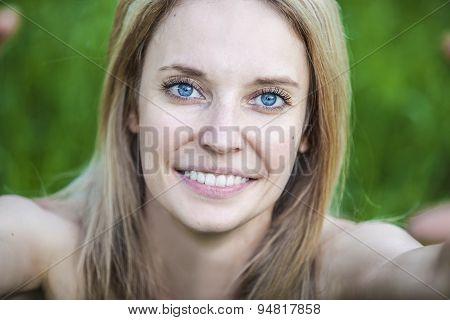 Portrait Of A Woman Doing A Self-portrait Closeup