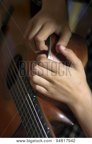 Acoustic Guitar And Girl's's Hands