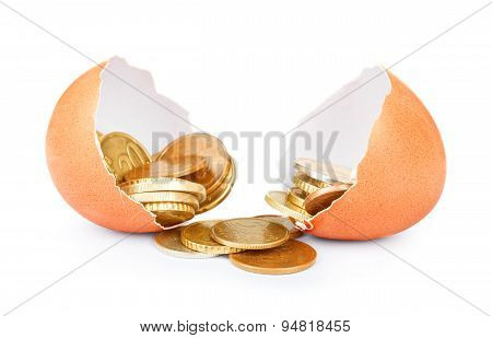 One Cracked Hen's Egg And Coins Isolated On White