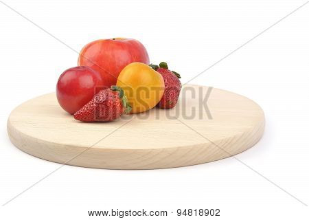 Apple, Plum And Strawberry On White Background
