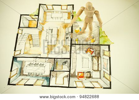 Real estate floor plan with wooden human model scale figure standing