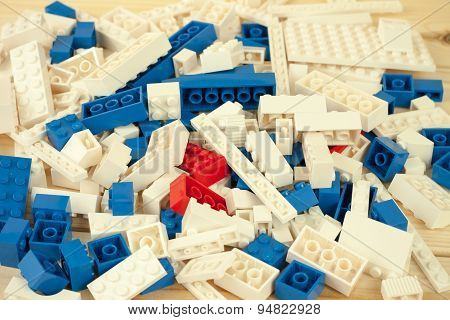 Sofia, Bulgaria - March 15, 2015: Heap of vivid white, red and blue toy kit blocks