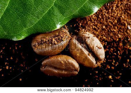 Closeup Shot Of Coffee Powder,beans With Green Leaf On Black