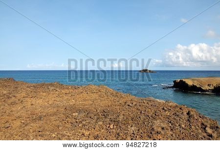 Rocky Plateau Over The Blue Waters