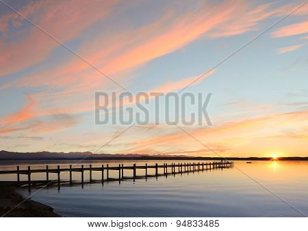 Lake Starnberg And Mountain Range At Sunset