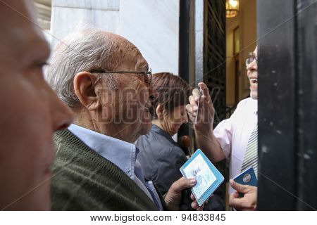 Pensioners Queue Outside A National Bank Branch As Banks Only Opened For The Retired To Allow Them T