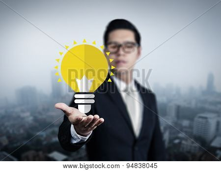 Concept, Idea Of Young Businessman With Bulb In Hand, New Business In The City Collection, Studio Sh