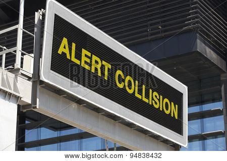 Alert Collision Signpost In The City With Building Facade Background
