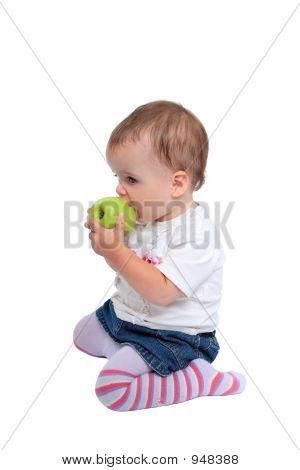 Young Baby Girl Eating Fresh Green Apple