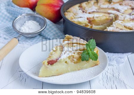 Slice Of Peach Clafoutis On A White Plate