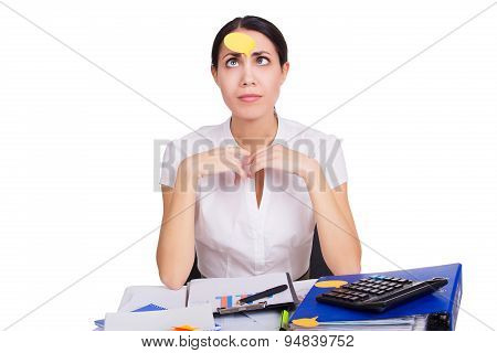 Young business woman sitting in office with clear reminder sticker on her face. Stress at work. Isol