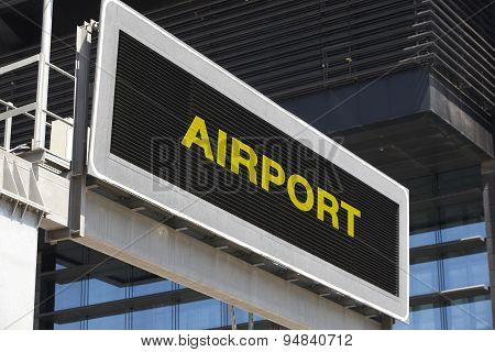 Airport Signpost In The City With Building Facade Background