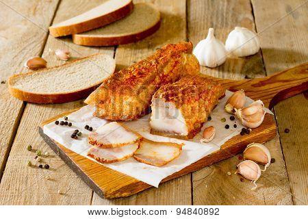 Salo, cured pork fat ,bacon on a wooden board.