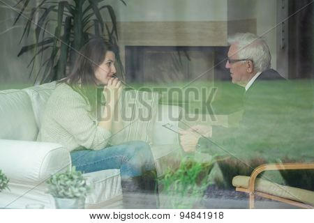 Retired Psychologist Consulting His Patient