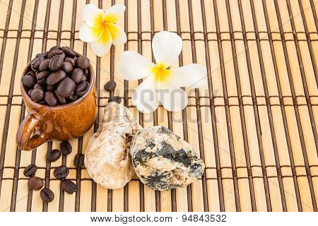 Coffee Cup And Coffee Beans With Stone Therapy On Wooden Background