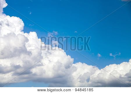 Puffy Cloud Against A Deep Blue Sky