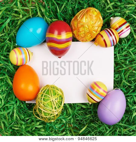 Easter eggs around white card