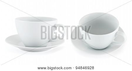 Two empty ceramic tea cup over white plate
