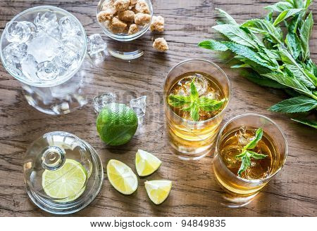 Glasses Of Rum On The Wooden Background