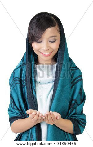 Smiling Muslim Girl Looking At Her Hands