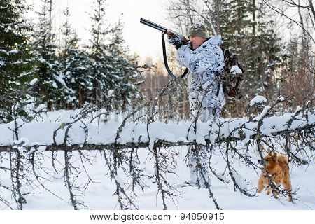 Hunter Shooting In Snowy Forest
