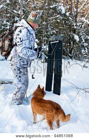Hunter With Skis And Dog