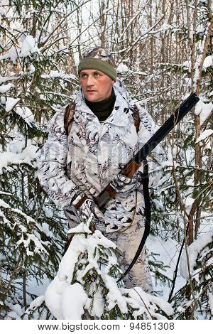 The Hunter In The Bushes In Winter