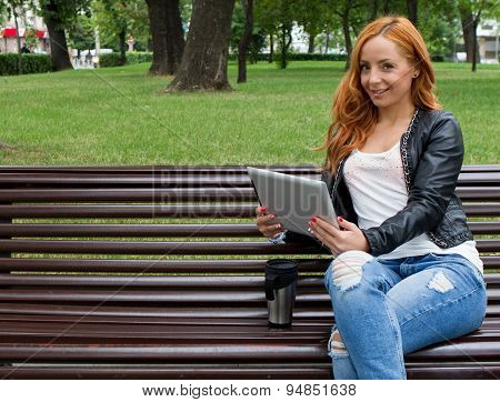 Pretty Girl Posing With A Tablet In Cafe
