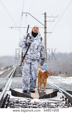The Hunter With His Dog On The Railroad Crossing