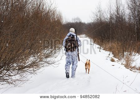 Hunter Walking On The Winter Road