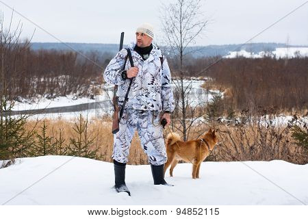 Hunter With Dog In Winter