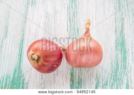 Organic Red Onion On Wooden Background